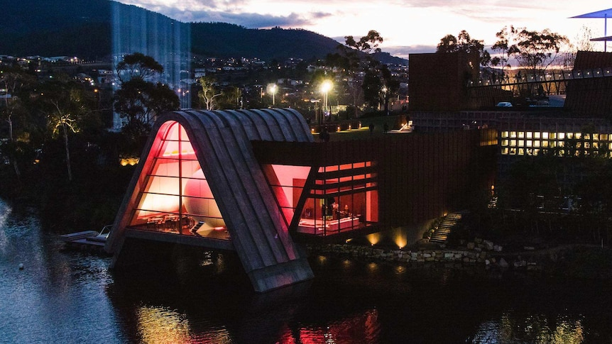 Exterior of Pharos restaurant at Hobart's MONA, as seen at twilight.