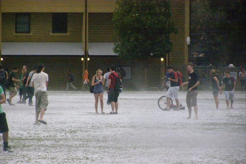UWA students get in amongst the hail at the Crawley campus.