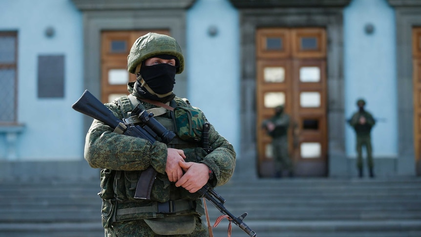 Armed soldier outside Crimean government building