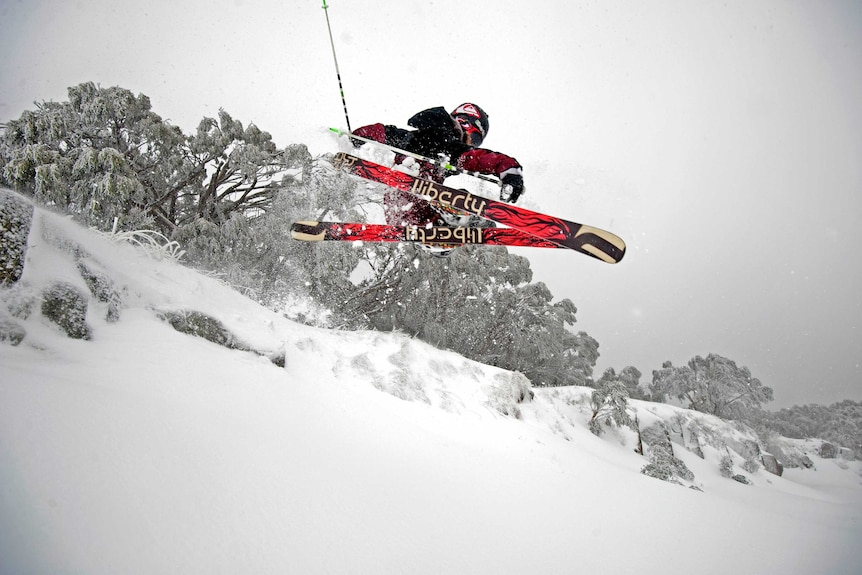 Mitch Reeves rides in fresh snow at Mt Buller.