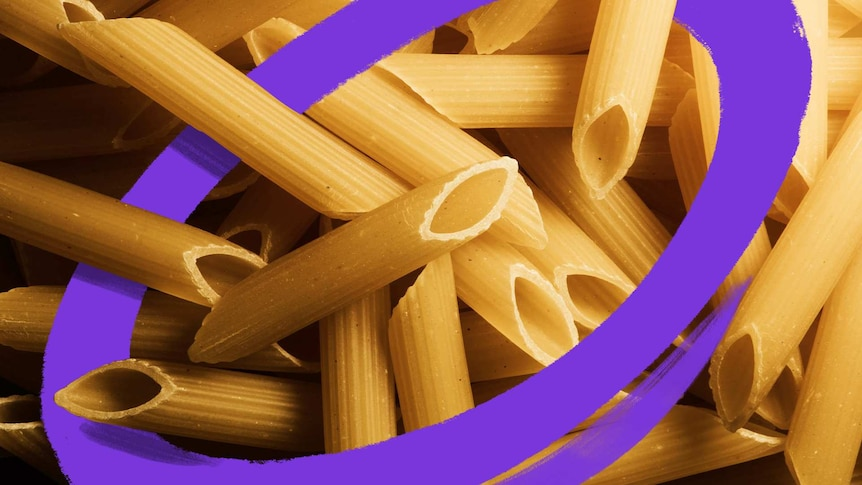 A close up photo of dried penne pasta, bought to cook during coronavirus.