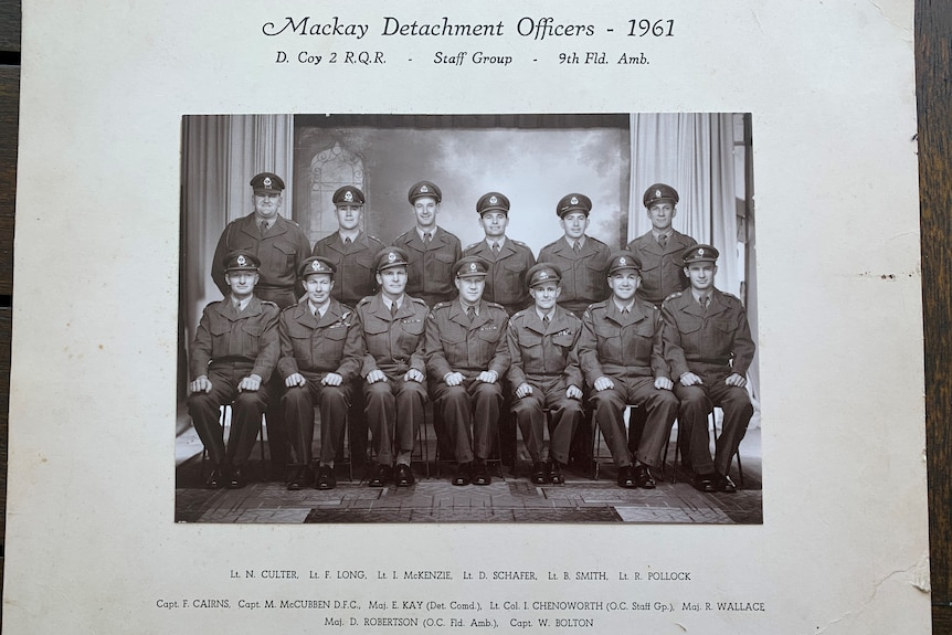 A black and white photo of a group of men in uniform with the heading Mackay Detachment Officers - 1961.