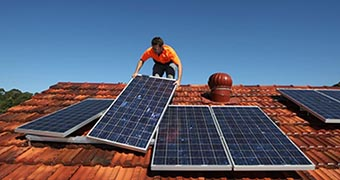 Solar panels are installed on a roof.