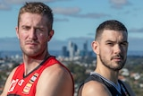 The Perth Wildcats and Melbourne United captains stand back to back with their arms folded.