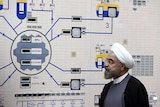 President Hassan Rouhani visits the Bushehr nuclear power plant, with a complex machine in front of him