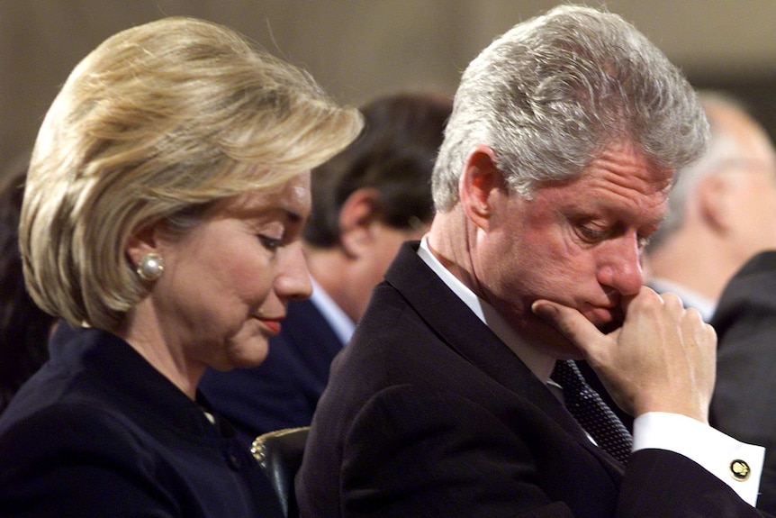 Bill and Hillary Clinton sitting next to each other