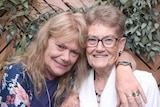 Sue Skeer hugs her mum Nan Walker as they both smile for the camera