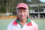 Man stares at camera at a bowling green