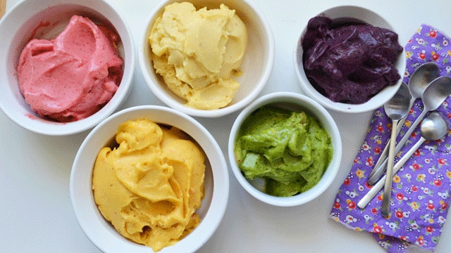 Four types of colourful gelati sit on a plate