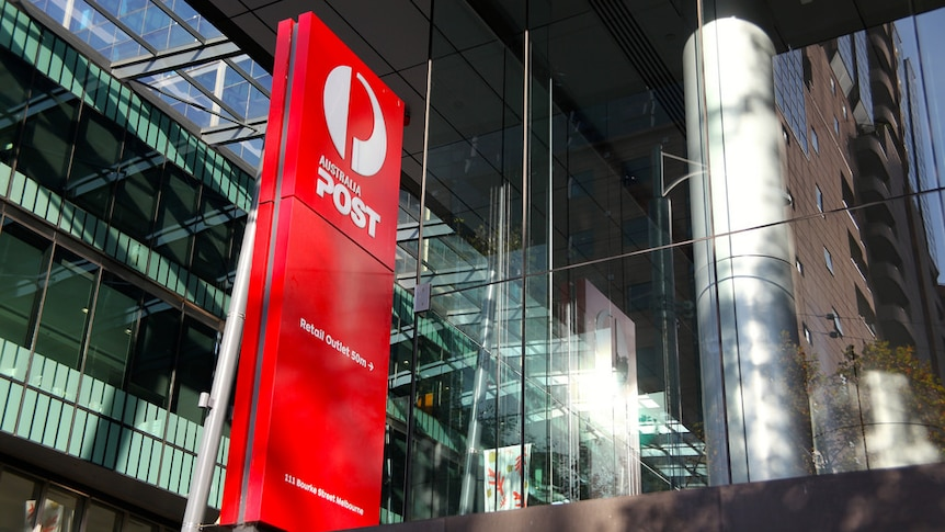 A red sign showing the white Australia Post logo indicates that there is a post office 50 meters away on Bourke Street.