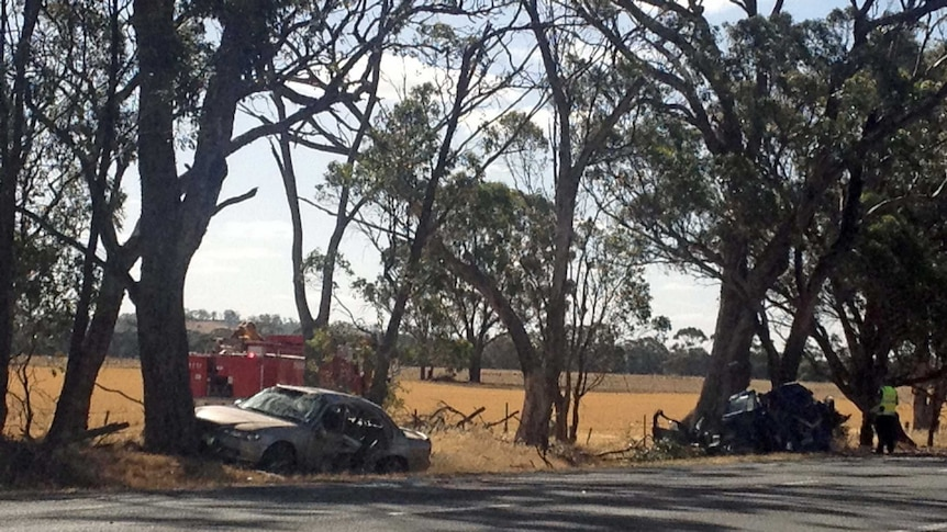 Two wrecked cars beside the road