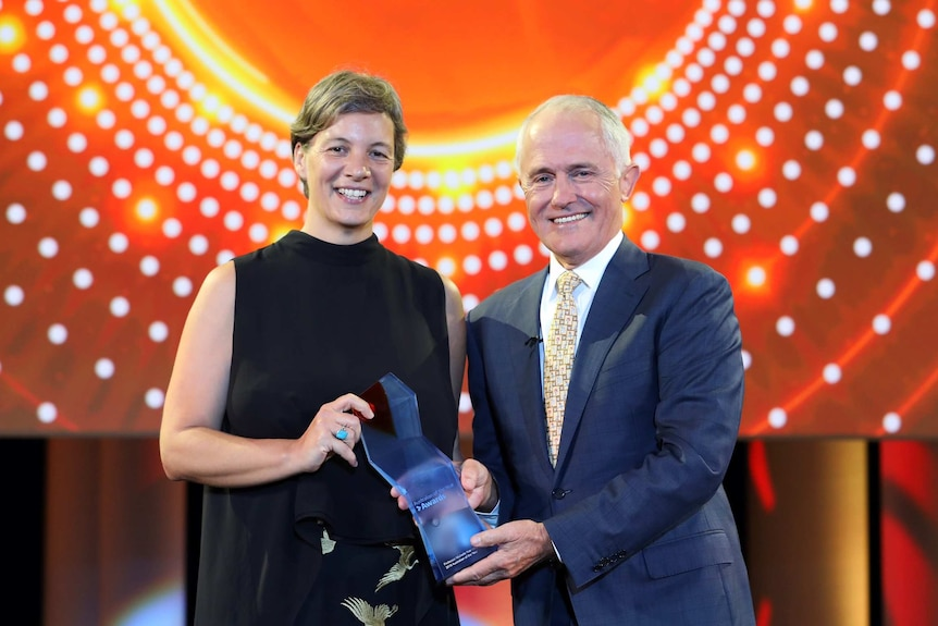 Michelle Yvonne Simmons stands with Prime Minister Malcolm Turnbull.