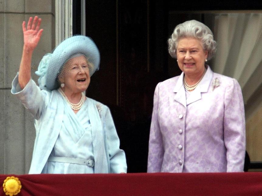 Queen Elizabeth II stands next to The Queen Mother on her 100th birthday.