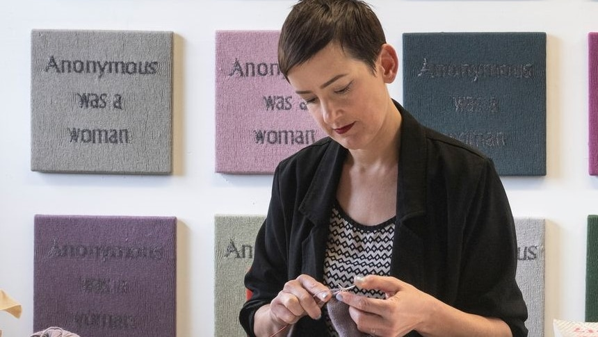 For the last two-and-a-half years, this artist has knitted the same four words