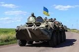 Ukrainian soldiers drive a military vehicle at a checkpoint near Slaviansk in eastern Ukraine.