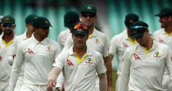 The Australian cricket team walk towards the camera.