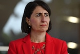 New South Wales Premier Gladys Berejiklian wearing red, fronting up to a coronavirus media conference.
