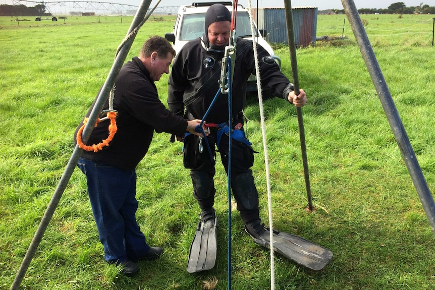 Gary Barclay preparing to lower diver and farmer Kelvyn Ball into The Shaft