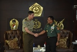 Lieutenant General Angus Campbell shakes hands with General Gatot Nurmantyo.