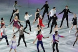 A group of ice skaters perform together at the Winter Olympics.