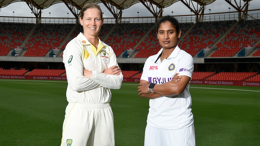 Meg Lanning and Mithali Raj stand with their arms folded in the middle of Carrara Stadium