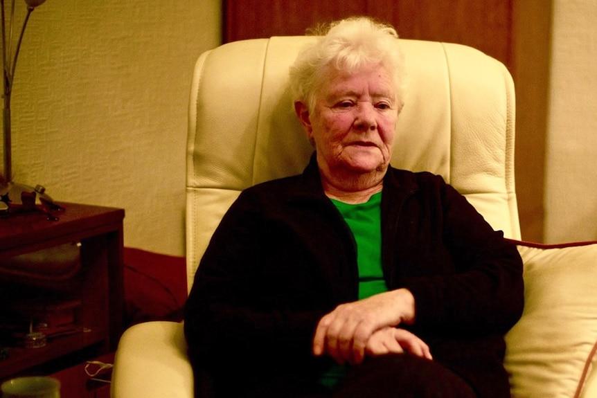 Elderly woman in a lounge chair