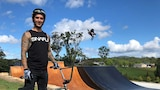 Professional Freestyle BMX rider Logan Martin in front of his backyard ramp park