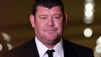 A portrait of James Packer in a suit.