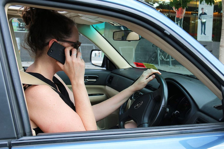Using a phone while behind the wheel: The RACQ expresses frustration at the arrogance of people using phones while driving.