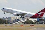 Qantas profits dive
