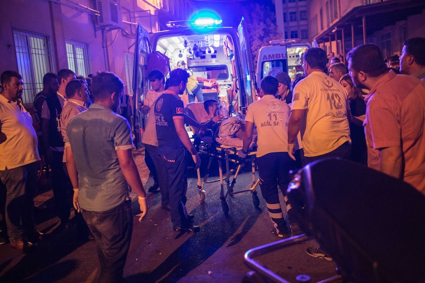 First aid officers carry an injured man to hospital in Turkey.