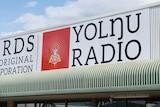 A photo of the Yolngu Radio station sign.