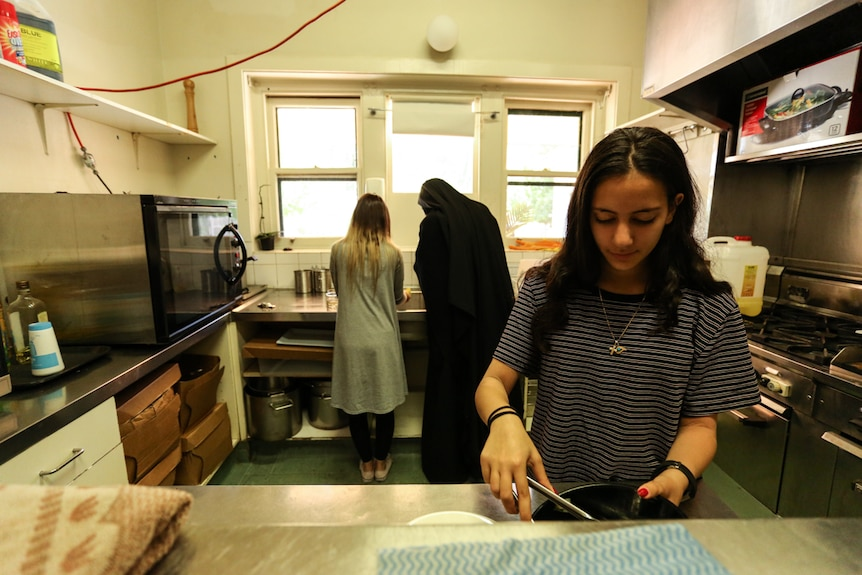 Young members of Melbourne's Coptic community help prepare food in the monastery's kitchen.