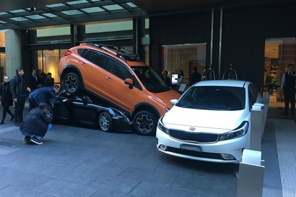 Two cars parked on top of each other outside Sydney's Hyatt Regency hotel on May 31, 2018.
