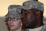 Bradley Manning (L) is escorted from the courthouse at Fort Meade on December 16, 2011.