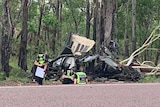 The crash site where five people were killed in a single vehicle rollover.