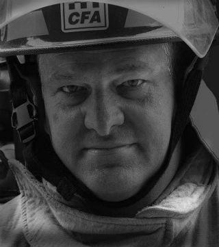A man wearing a firefighter's hat