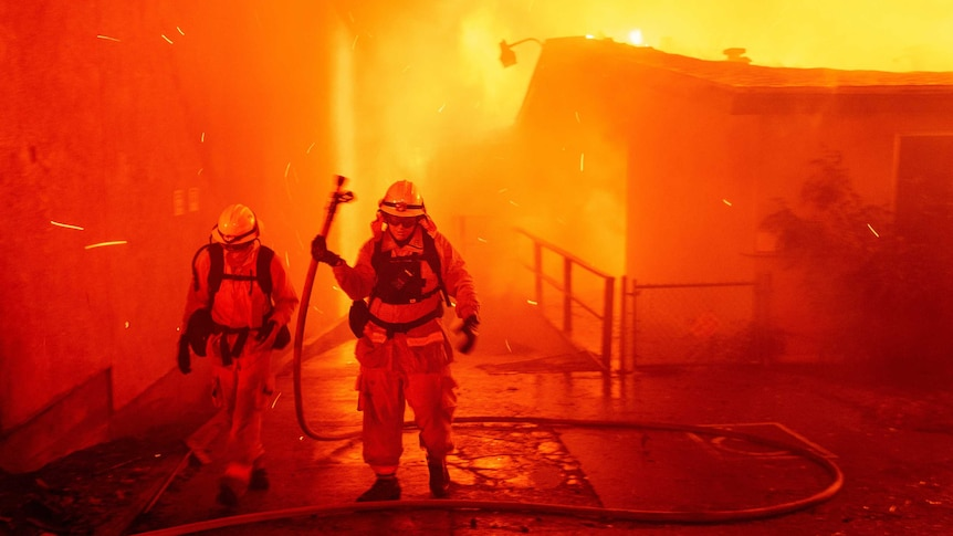 California wildfires spread, with thousands fleeing
