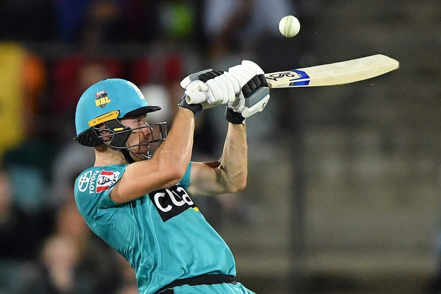 Brisbane Heat batsman Sam Heazlett plays a shot up at the cricket ball during a Big Bash League game.