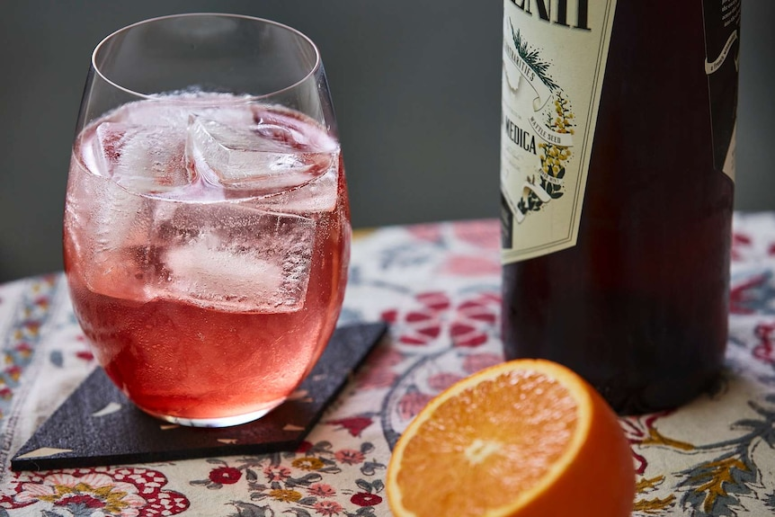 Vermouth in a glass to depict a collection of low-alcohol cocktail recipes.