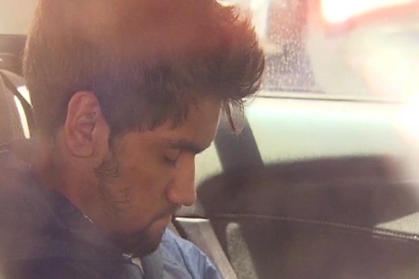 Codey Herrmann in a car on the way to court.