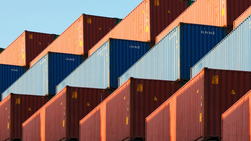 A large stack of shipping containers.