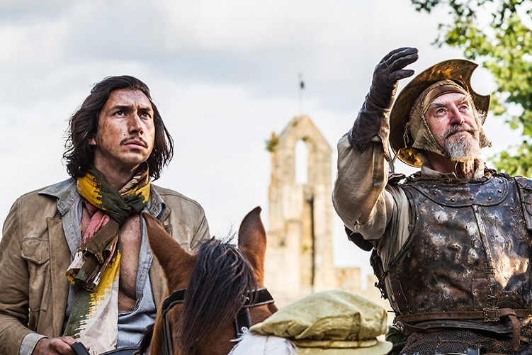 Colour still of Adam Driver and Jonathan Pryce sitting on horses in 2018 film The Man Who Killed Don Quixote.