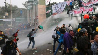 Students clash with police armed with water cannons and tear gas