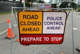 """A sign at the Coolangatta border reads """"Road Closed ahead, police control ahead"""""""