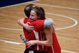 Jo Hill hugs coach Brenton Johnston after her last match
