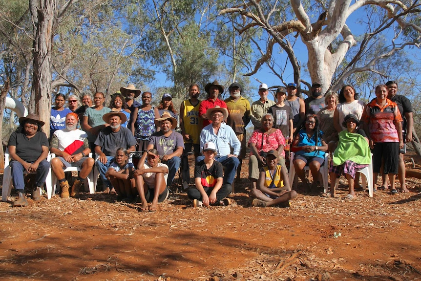 a group of people in the bush