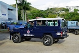 A Special Services Directorate police car in Papua New Guinea. It is a blue 4WD with the letters 'SSD' printed on it.