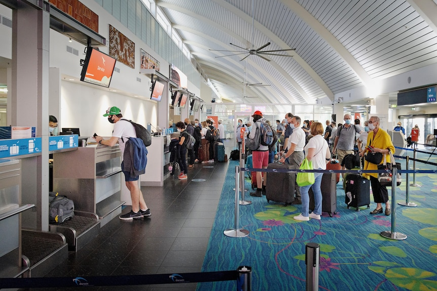 A long line at the Darwin Airport check-in counter during the COVID-19 lockdown.