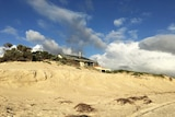 Some Adelaide coastal housing is very close to the sand at Tennyson